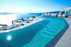 It is in Oia, Greece, the westernmost point of the island of Santorini. It is a luxury hotel that has stunning views of the Aegean Sea and is on a cliff, with different levels. It is a perfect place to enjoy the weather as it has infinity pools that appear to merge with the sea.
