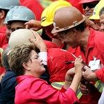 Brazilian President Dilma Rousseff (L) greets construction workers during the opening of the brand new Beira Rio Stadium during the 2014 FIF...