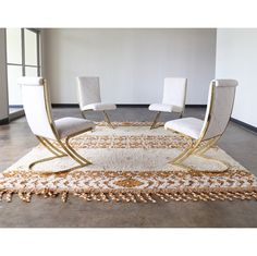 For Sale: A stunning set of rare vintage Pierre Cardin cantilevered brass dining chairs completely re-upholstered in our Augusta fabric a creamy off white base with metallic gold marbled veins woven in.