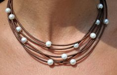 Freshwater Pearl and Leather Necklace 5 Strand Brown. $89.00, via Etsy.