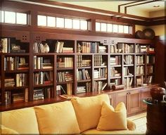 Craftsman Style library built in shelves, great transom windows above, too