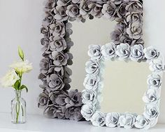 diy decorated mirror made with dollar store flat stones :) i have