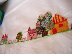 embroidered crib sheet and pilowcase colorful village