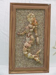 mermaid mosaic in seashells. So cool! I want to do a seashell mosaic :)