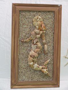 mermaid mosaic in seashells. So cool! I want to do a seashell mosaic :)