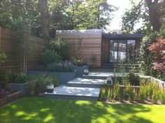 Western Red Cedar cladding and horizontal slatted screen fencing... by Miles Raybould - Belsize Gardens
