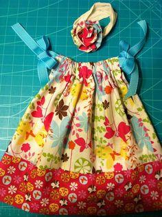 Pillowcase dress with hair bow.