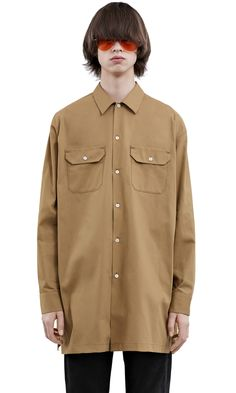 f3e4c5887dc Acne Studios Santos twill beige is an elongated version of a utility shirt  with an oversized fit.