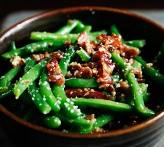 Green beans with crumbled bacon and candied pecans dressed with olive oil, maple syrup, Dijon mustard, red wine vinegar, garlic, salt & pepper. This side dish is a great way to dress up green beans.