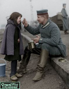 A German soldier shares his lunch with a young girl.Original image source: Nationaal Archief - pin by Paolo Marzioli