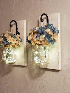 Beautiful set of 2, wall decor, hanging distressed sconces with swirled hooks, mason jars, hydrangeas flowers and warm starry lights