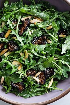 Five-Minute Arugula Fig Salad The simplest five-minute arugula salad recipe with figs and toasted almonds. Easy enough for weeknights and festive enough for the holiday table, this back-pocket arugula salad recipe hardly needs a recipe! Fig Salad, Arugula Salad Recipes, Healthy Salad Recipes, Vegetarian Recipes, Cooking Recipes, Beet Salad, Simple Salad Recipes, Winter Salad Recipes, Christmas Salad Recipes