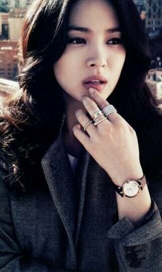 love her rings, watc, jacket and hair.