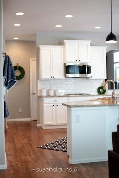 Household No.6 » Northern Colorado renovations and designs. White kitchen remodel. Rustic modern, Black pendants. White subway tile, grey grout, grey paint.