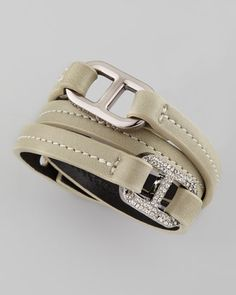 """Tory Burch 125 USD  Pave Plato Link Patent Bracelet, Peruvian Opal  Tory Burch mixes textures for a modern, multidimensional look.  Wrap construction forms three straps of leather. One smooth gunmetal-colored link; one link set with pave crystals and engraved with logo lettering. Approximately 22""""L. Snap closure."""