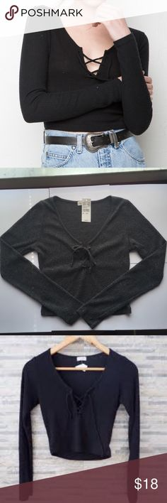 NWT Brandy Melville Elie Top NWT Brandy Melville Elie Top in black. It is cropped. Brandy Melville Tops Crop Tops