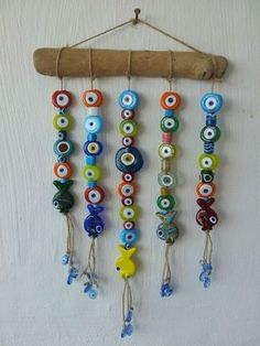 EV AKSESUARLARI. Colorful evil eye mobile for home. My favorite stuff on my wall at the work area. Diy. #mobile #Turkey #Bodrum Penny Rugs, Evil Eye, Turkish Art, Stone Painting, Wind Chimes, Dream Catcher, Stone Art, Mobiles, Home Accessories