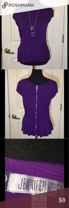 Jennifer Lopez Purple Peplum Top Large Jennifer Lopez purple top.  Tshirt Knit. Peplum style.  Back has exposed zipper. Necklace not included.  Size large.  Good condition.   Important:   All items are freshly laundered as applicable prior to shipping (new items and shoes excluded).  Not all my items are from pet/smoke free homes.  Price is reduced to reflect this!   Thank you for looking! Jennifer Lopez Tops Tees - Short Sleeve