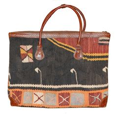 $359: The traditional flat woven rugs of the Middle East, Kilims are prized for their intricate patterns, vibrant colors and retention of indigenous designs. Now these beautiful Turkish textiles can grace your arms instead of your floors. Apadana presents a collection of handbags crafted from bold, geometric vintage kilim fabrics. This handbag features brown leather trim and handles and a zippered exterior pocket.Turkish Kilim Medium Bag I now featured on Fab.