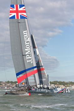 Sir Ben Ainslie's America's Cup wingsail catamaran 'J.P.Morgan BAR' approaching the finish line at Cowes during the J.P. Morgan Asset Management Round the Island Race. Ainslie set a new race record of 02:52:15.