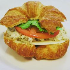 """Amy & Tammy's- """"THE SHAG""""  It's our delicious chicken salad surrounded by Provolone cheese, lettuce, tomato, and a slice of green apple, all of which is on a fluffy croissant. Try one out at your next meeting and we're sure it'll be a hit!"""