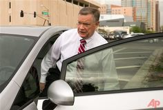 Former Fiesta Bowl executive director John Junker gets into his car outside the Sandra Day O'Connor U.S. courthouse after being sentenced in Phoenix on in this March 13, 2014 file photo. The sentencing Thursday March 20, 2014 of 58-year-old John Junker in Maricopa County Superior Court will mark the end of criminal cases that arose from the contribution scandal that jeopardized the bowl's NCAA license and led to the ouster of the longtime bowl leader. (AP Photo/The Arizona Republic, Michael…