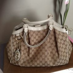 GUCCI MEDIUM SUKEY BAG Purchased from another Posher.  Well loved but in good condition.  Does have stains on inside and outside.  Also leather needs cleaning.  THINKING OF SELLING IF PRICE IS RIGHT!  I can clean this bag up so it looks almost new if I don't sell as is.  NO TRADES.  NO PAYPAL. Gucci Bags