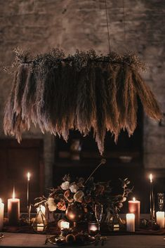 Pampas Grass Chandelier. Dark and moody castle wedding. Floral installation. Game of thrones. Labyrinth Styling by My Pretties UK