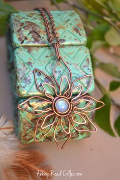 Bohemian Flower Mandala Pendant// Rainbow Moonstone and Copper Pendant This elegant flower was hand crafted from pure copper wire to create this beautiful mandala style flower with a stunning rainbow moonstone in the center. *This pendant is handwrapped in pure copper wire. It