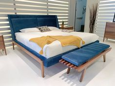 Modern Upholstered bed with exposed wood frame.  13 Spring 2019 Design Trends Seen at High Point Market | Cozy•Stylish•Chic  #Bed available at Cozy Stylish Chic Modern Upholstered Beds, Design Trends, Cozy, Universal Furniture, Bed, Modern Upholstery, Cuddle Sofa, Living Wall, Upholstery
