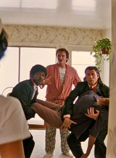 qjerometarantino:  Samuel L. Jackson, Quentin Tarantino, and John Travolta in Pulp Fiction