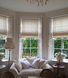 Ribbon trimmed Roman blinds in Sarah Hardaker's white linen. Made by Oak House Design www.oakhousedesign.co.uk