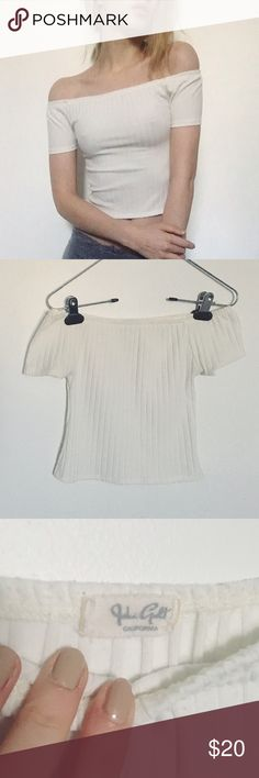 Off the shoulder crop top Best fits a xs/s. Some pilling around the top but not noticeable when worn. No stains. Off white/cream color. Super cute. John Galt sold at Brandy Melville.  •no trades or holds✖️ •I'm only on poshmark✔️ •use offer button please •same/next day shipping Brandy Melville Tops