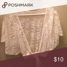 Short sleeved lace cover up A beautiful all lace crop top that ties in the front. Wear over your favorite tank or over that cute bikini at the beach! Tops Crop Tops