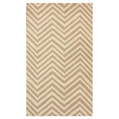 Hand-hooked wool rug with a cream chevron motif.  Product: RugConstruction Material: 100% WoolColor: CreamFeatures: Hand-hookedNote: Please be aware that actual colors may vary from those shown on your screen. Accent rugs may also not show the entire pattern that the corresponding area rugs have.Cleaning and Care: Spot treat with a mild detergent and water.  Professional cleaning is recommended if necessary.