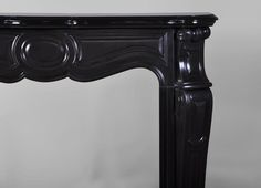 Detail of #antique #Pompadour #fireplace #mantel in Black from Belgium #marble #19thcentury  #frenchantiques #interiordecoration #black #decor #design #louis15 #french #style Available on #MarcMaison website