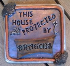 This house protected by Dragons by reginagreenway on Etsy