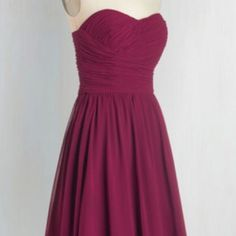 Luminous and Lovely Dress in Raspberry NEVER WORN. Shell: 100% Polyester. Lining: 100% Acetate. Fabric does not provide stretch. Dry clean. Fully lined. Semi-sheer skirt. Back zipper with hook and eye closure. Non-slip strip at top. Bust cups. Padded interior corset with boning and hook and eye closure. Donna Morgan Dresses Strapless