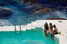 Australia, New South Wales, Sydney. Swimmers at the Bondi Icebergs swimming pool at Bondi Beach