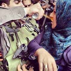 On March 30, 2014, Land Day, an Israeli soldier sprays tear gas into a Palestinian woman's face in Jerusalem. Land Day is an annual day of commemoration for Palestinians in response to the Israeli government's announcement of a plan to expropriate large swathes of land for security and settlement purposes in 1976.