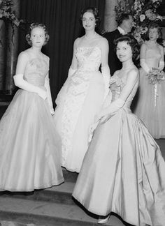 Stunning silk evening gowns from 1958!  These were some of England's young debutantes who were fortunate to be presented in court before Queen Elizabeth II ~ right before the custom came to an end!