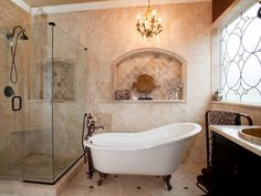 A freestanding ceramic tub is the focal point of this large bathroom that includes a glass-enclosed shower with seamless doors.
