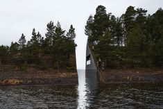 "Norway's Memorial Shows a Cut Within Nature | Swedish artist Jonas Dahlberg's design of a symbolic wound, or a cut within nature, was unanimously chosen for being ""artistically highly original and interesting.""   The cut is a three-and-a-half-meter wide excavation on the Sørbråten peninsula, which faces the island of Utøya. The gap will now make it impossible to reach the end of the headland. The names of the victims will be engraved onto a wall but visitors will not be able to touch them."