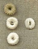 Thread buttons were used on men's shirts and other undergarments from the late 17th into the early 19th century.