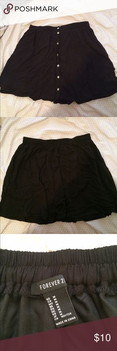 Black Skirt Black button up skirt (buttons go up the front). Worn once! Falls above the knee. Forever 21 Skirts Mini