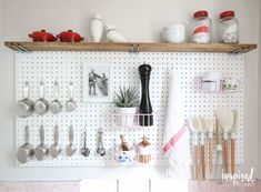 kitchen peg board - great way to organize baking supplies! (Inspired by Charm)