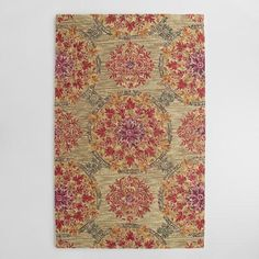 One of my favorite discoveries at WorldMarket.com: Coral Medallion Tufted Wool Julianna Area Rug