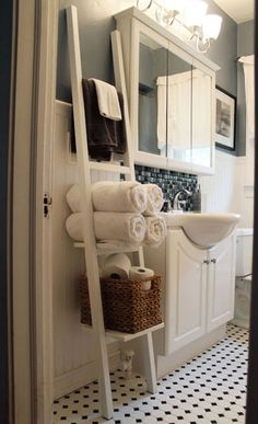 Looking for bathroom shelving that won't take up too much space? Try leaning a crisp white ladder against a wall and packing it full of towels and toiletries. Get the tutorial at Hammers & High Heels.