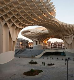 Metropol Parasol in Seville, Spain by J. Mayer Architects : Made of interwoven waffle like panels made of wood and steel which are held together by polyurethane sealant. via yatzer Architecture J_Mayer_Architects Metropol_Parasol Seville Spaiin Architecture Design, Futuristic Architecture, Beautiful Architecture, Contemporary Architecture, Landscape Architecture, Wooden Architecture, Architecture Quotes, Contemporary Design, Amazing Buildings