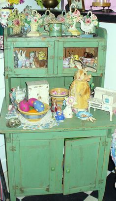 Makes me smile ...adorable little green cupboard & contents.